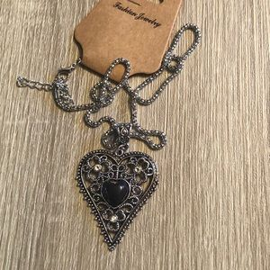 """Silver heart shaped necklace on an 18"""" chain"""